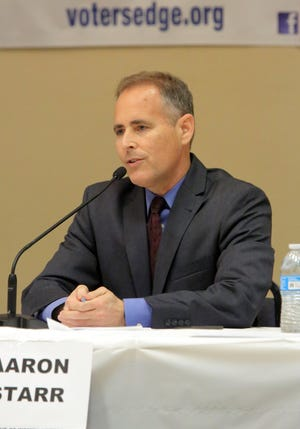 Aaron Starr is seen in this 2018 photo during a mayoral candidate debate in Oxnard.