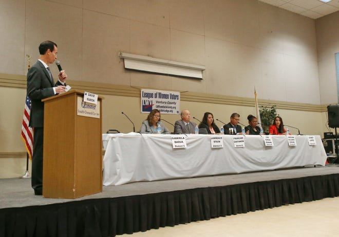 David Maron, a member of the League of Women Voters Ventura Count, is seen moderating a candidates forum in south Oxnard last month. Maron and California Lutheran University Professor Herb Gooch have produced a couple of videos explaining the propositions on the November ballot.