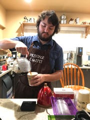 Carlos Larios serves a beverage at Heritage Coffee, the coffeehouse his family opened this week at Heritage Square in Oxnard. The business specializes in single-origin espressos and pour-overs made from beans roasted in Thousand Oaks by Gear Grinderz Coffee.