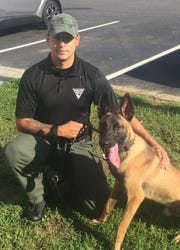Franklin Township Officer Michael Guzman with K-9 Rozo.