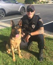 Franklin Township Police Officer Josh Fennimore with K-9 Lito.