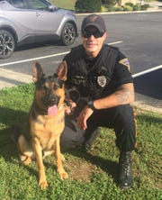 Franklin Township Police Officer Josh Fennimore with K-9 Lito.