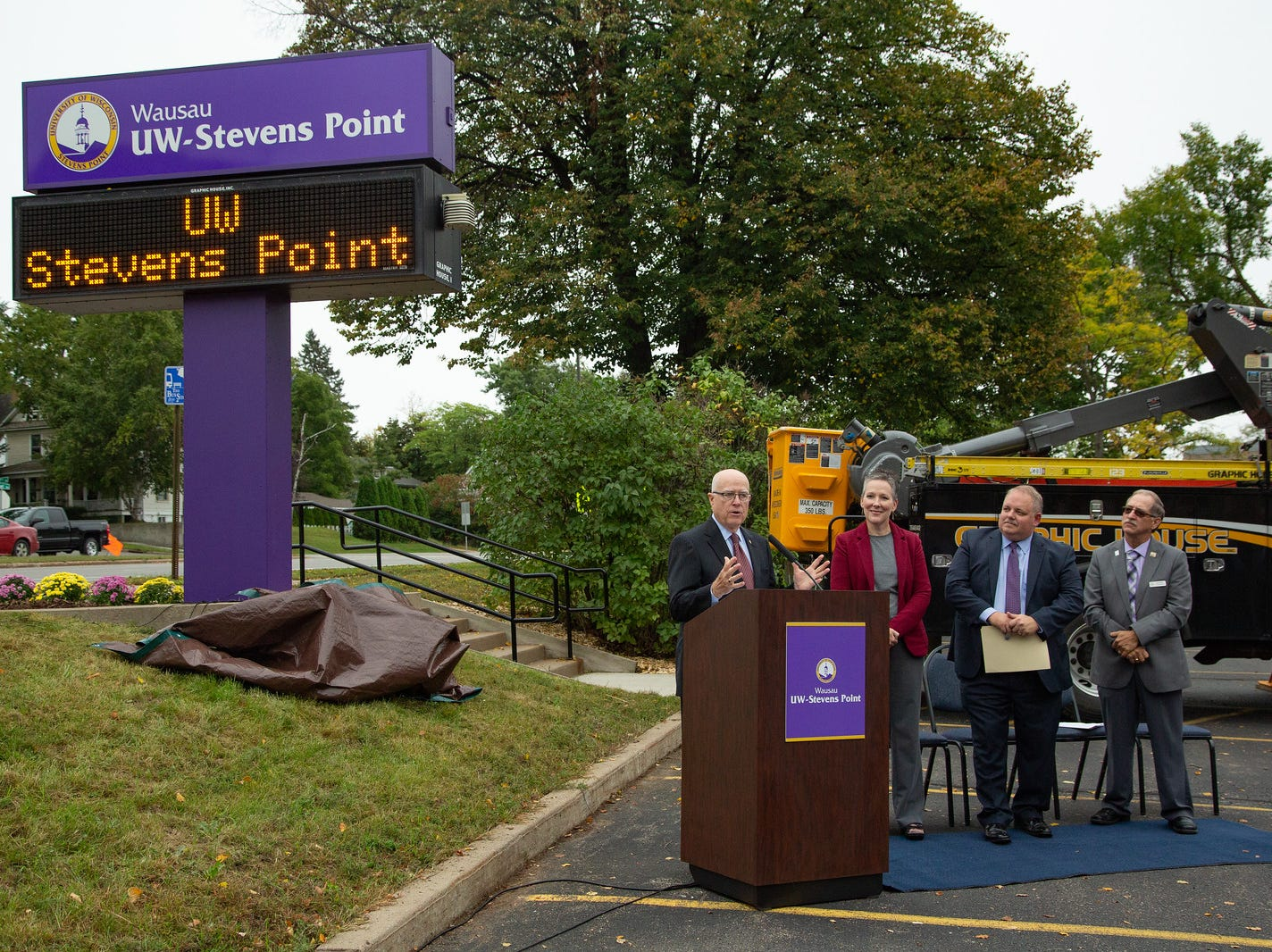 UW-Stevens Point Chancellor Bernie Patterson, Wausau Campus Executive Ann Herda-Rapp, Wausau Mayor Robert Mielke and Marathon County Board Chairman Kurt Gibbs spoke at the Wausau sign unveiling.