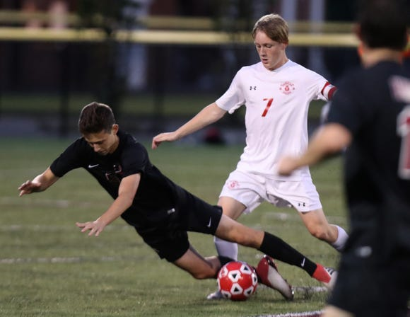 Nyack's Julian Brooks, left, fights for the ball with Tappan Zee's Ciaran Shalvey during their game at Nyack Sept. 26, 2018. Tappan Zee won 5-2.