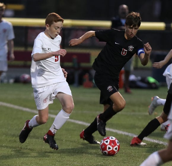 Tappan Zee's Dylan Shalvey, left, advances the ball during a game at Nyack Sept. 26, 2018. Tappan Zee won 5-2.