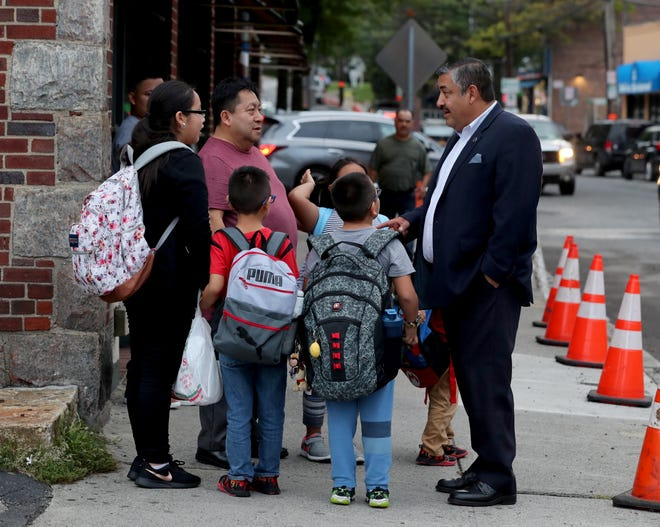 Port Chester village trustee Luis Marino, right, chats with village resident Juan PIntado and his children and grandchildren  on Westchester Ave. in the village Sept. 26, 2018. Marino, the first Hispanic trustee in village history, was elected after the village enacted cumulative voting, a system in which voters can vote as many times as there are positions to fill.
