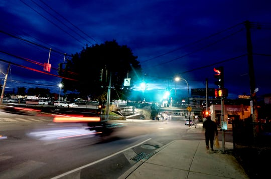 Pedestrians as well as drivers make their way along Westchester Ave. in Port Chester as they start their day before sunrise Sept. 27, 2018.