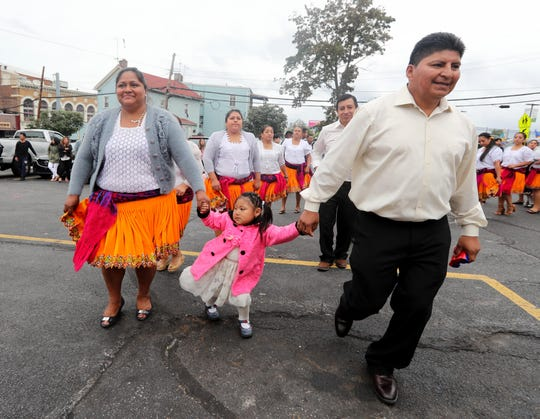Members of the Ecuadorian community dance during a celebration of the Feast of the Virgin of El Cisne, an Ecuadorian religious festival Sept. 9, 2018. The celebration was held in the parking lot of St. Peter's Episcopal Church in Port Chester.