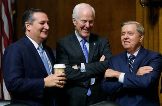 """Sen. John Cornyn R-TX (center) had strong words about  Thursday's Senate Judiciary Committee hearing on Supreme Court Nominee Brett Kavanaugh saying, """"I can't think of a more embarrassing scandal for the United States Senate since the McCarthy hearings"""".  He voted yes on Kavanaugh."""