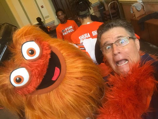 David Raymond with Gritty. Raymond is the man behind the Philadelphia Flyers' much-talked-about mascot.