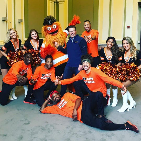 David Raymond (center) with Gritty  and the Philadelphia Flyers Fun Patrol rally team.