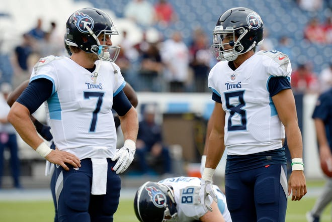 FILE - In this Sept. 16, 2018, file photo, Tennessee Titans quarterbacks Blaine Gabbert (7) and Marcus Mariota (8) talk before an NFL football game against the Houston Texans, in Nashville, Tenn. With backup Gabbert in concussion protocol, the Titans have little choice but for Mariota to start at quarterback against Philadelphia. (AP Photo/Mark Zaleski, File)