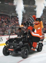 Philadelphia Flyers mascot shoots t-shirts into the crowd on Thursday during a break in the team's preseason game against the New York Rangers.