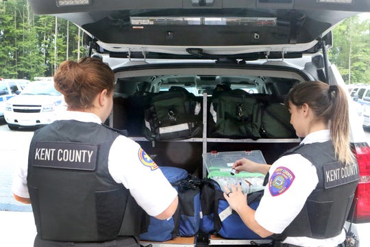 Kent County paramedics Jennifer Sweetman (left) and Michelle Zaffora (right) test equipment and make sure their vehicle is fully stocked for any emergency call.