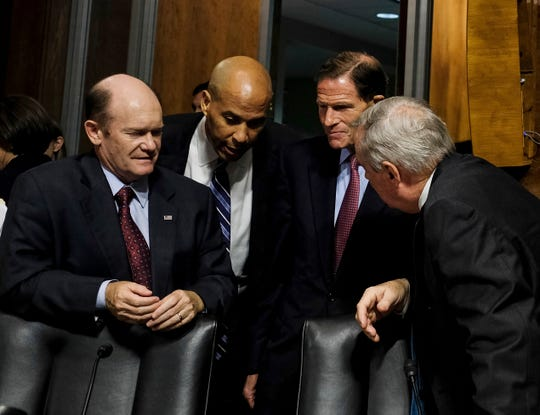 From left, Sen. Chris Coons, D-Del., Sen. Cory Booker, D-N.J., Sen. Richard Blumenthal, D-Conn., and Sen. Sheldon Whitehouse, D-R.I., talk during a break in the hearing for Supreme Court nominee Judge Brett M. Kavanaugh before the Senate Judiciary Committee, Thursday, September 27, 2018 on Capitol Hill in Washington. (Gabriella Demczuk/The New York Times via AP, Pool)