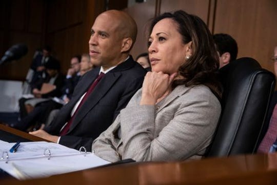 "Sen. Cory Booker D-N.J., left, said to nominee Brett Kavanaugh that ""(Christine Blasey Ford) is a woman who came here with corroborating evidence to tell her truth."" He voted no on Kavanaugh."