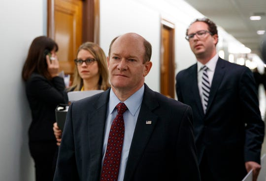 Sen. Chris Coons, D-Del., arrives for the Senate Judiciary Committee hearing on Capitol Hill in Washington, Thursday, Sept. 27, 2018, with Christine Blasey Ford and Supreme Court nominee Brett Kavanaugh. (AP Photo/Carolyn Kaster)