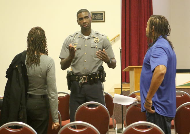 Dover police chief Marvin Mailey Jr. talks about his department's community policing effort with two residents attending Thursday's open community forum hosted by the Dover Police Department, along with the Delaware Chapter of NOBLE (National Organization Of Black Law Enforcement Executives).
