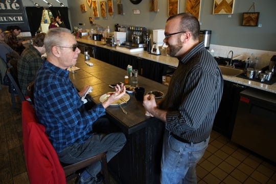 Greg Vogeley, owner Drip Cafe in Hockessin, visit with Paul Shearer, a regular customer at the cafe. A second location is coming to Newark in October.