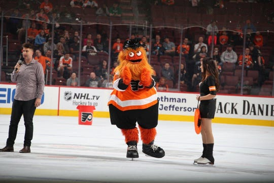 Philadelphia Flyers mascot Gritty hits the ice at Wells Fargo Center on Thursday during a break in the team's preseason game against the New York Rangers.