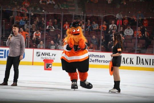 Philadelphia Flyers mascot Gritty hits the ice at Wells Fargo Center on Thursday during a break in the team's preseason game against the New York Rangers.