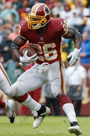 Washington Redskins running back Adrian Peterson (26) carries the ball during the second half of an NFL football game between the Washington Redskins and the Green Bay Packers, Sunday, Sept. 23, 2018 in Landover, Md. The Redskins defeated the Packers 31-17. (AP Photo/Alex Brandon)