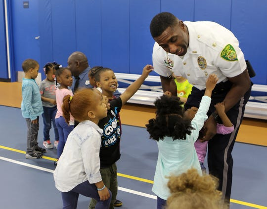 New Dover police chief Marvin C. Mailey Jr. interacts with kids at the Greater Dover Boys & Girls Club on Tuesday after addressing the launch of the Just(ice) In Time adult training program. He said he wants the youth of Dover to see who police really are and not to fear them. (Jerry Smith/The News Journal)