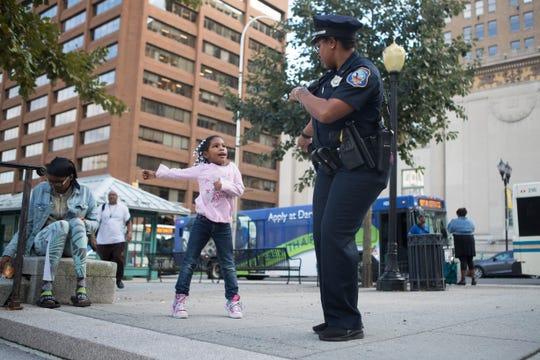 Master corporal with the Wilmington Police Department Kennita Champion, right, dances with Ilyana Boyd Friday at the Wilmington Love Block Party at Rodney Square.