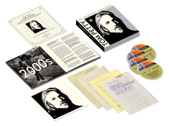 The 'An American Treasure: Super Deluxe Limited Edition' includes the four-CD set of 60 tracks from the career of the late Tom Petty, along with a 84-page hard back book with rare photographs, a cover art lithograph and reproductions of Petty's handwritten lyrics.