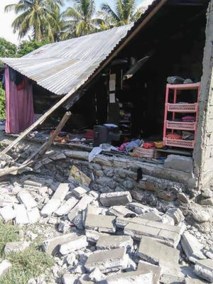 This handout photograph taken and released on Sept. 28, 2018 by Indonesia's National Agency for Disaster Management shows a collapsed house following an earthquake in Donggala, Central Sulawesi.