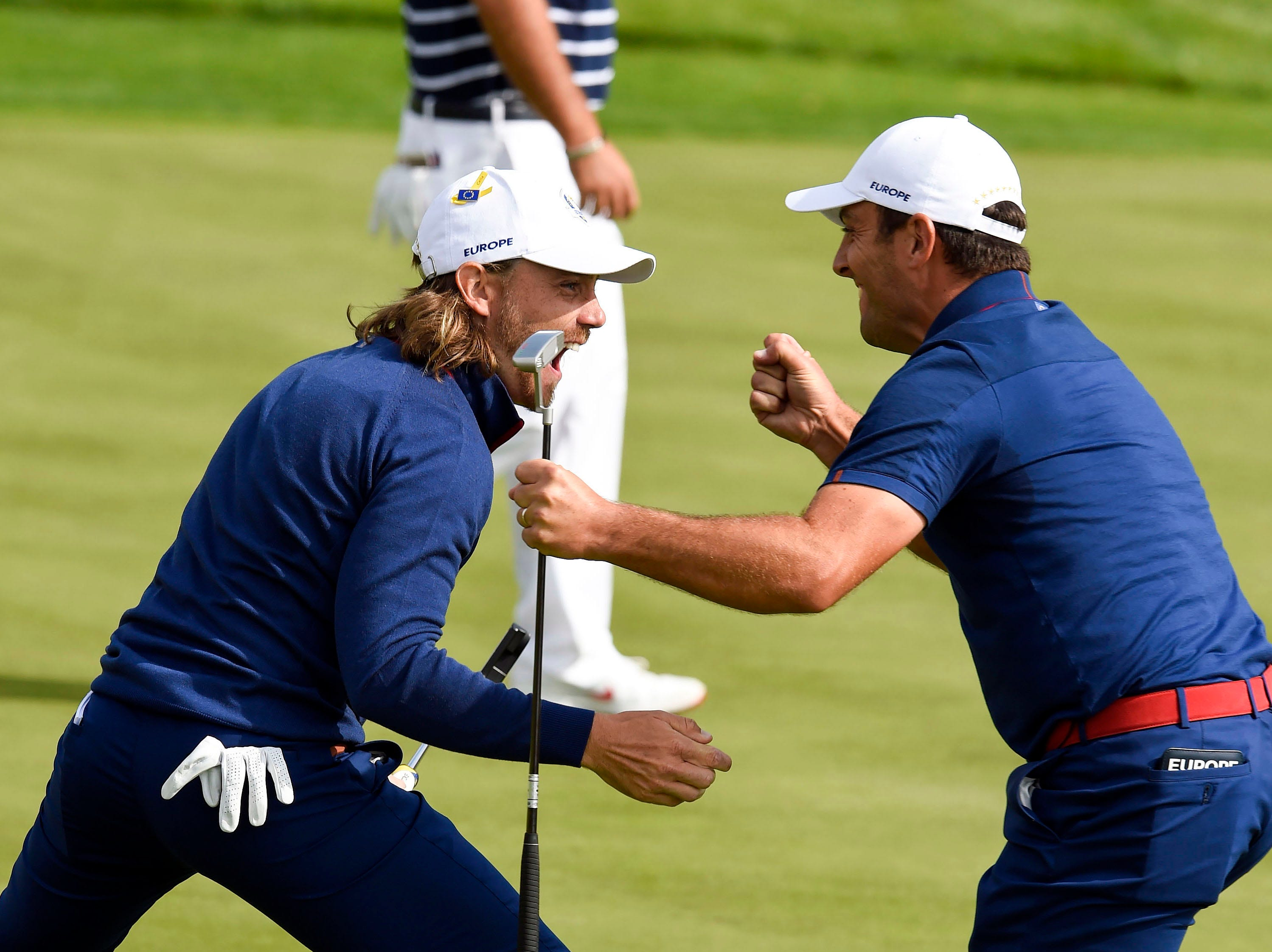 Europe's Tommy Fleetwood and Francesco Molinari react to winning their match on the 17th green during the Ryder Cup Friday morning matches.