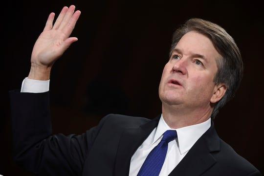 Supreme court nominee Brett Kavanaugh is sworn in to testify before the Senate Judiciary Committee Sept. 27 in Washington.