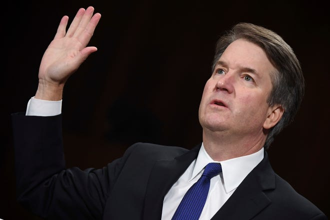 Supreme court nominee Brett Kavanaugh is sworn in to testify before the Senate Judiciary Committee  Thursday in Washington.