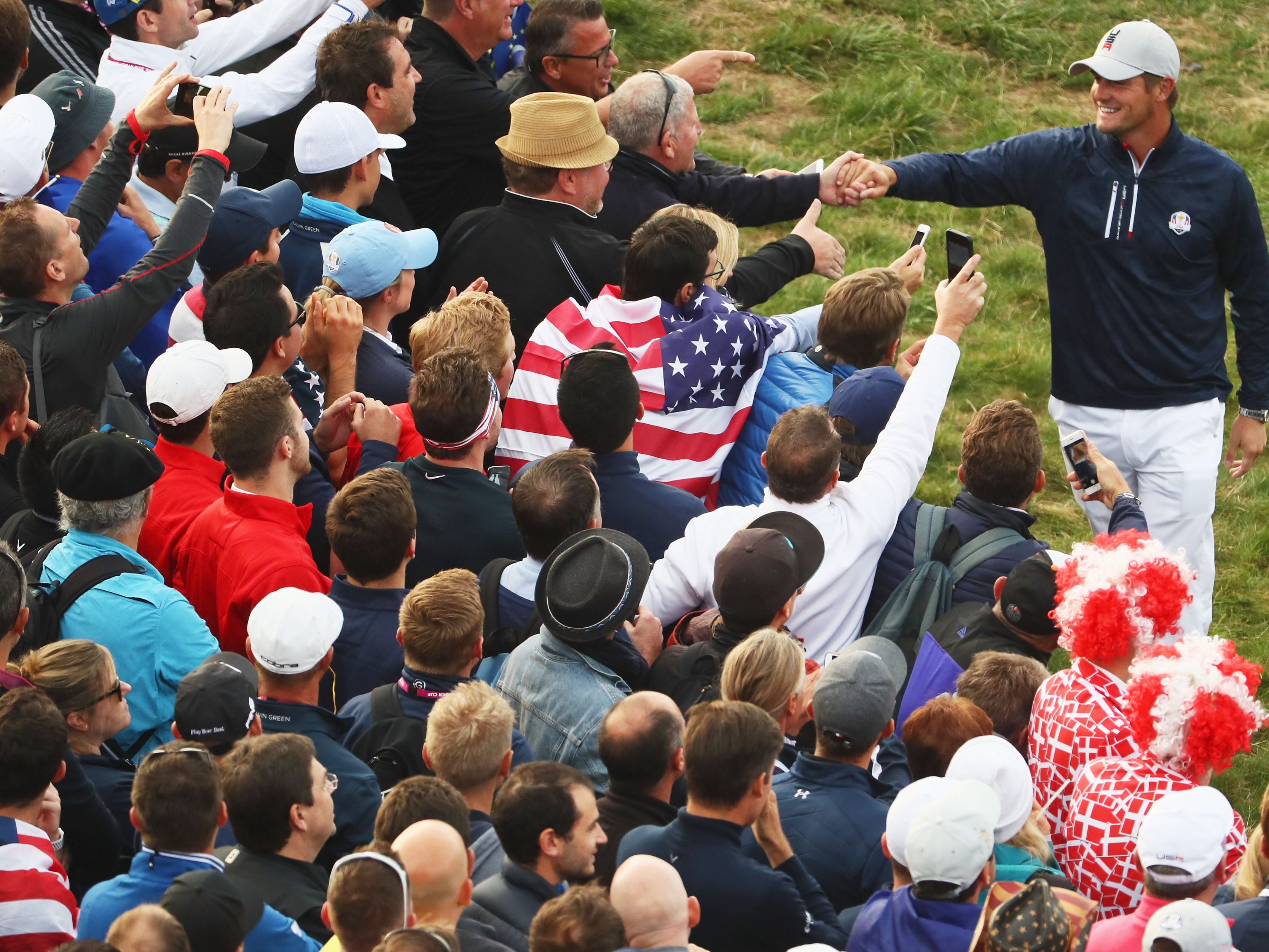 Bryson DeChambeau of the United States meets the fans during the morning fourball matches of the 2018 Ryder Cup at Le Golf National on Sept. 28.