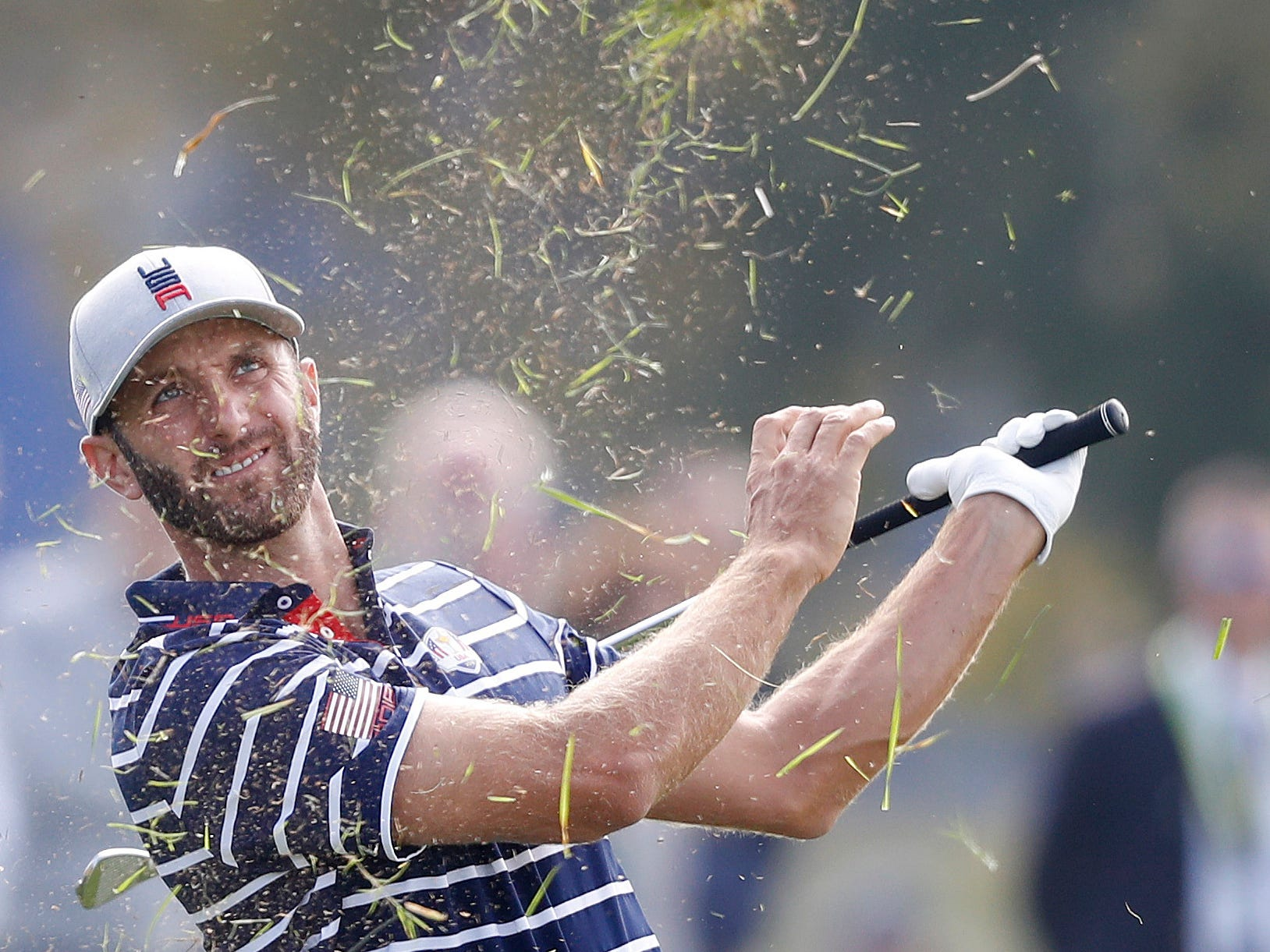 USA's Dustin Johnson plays out of the rough during his fourball match on the opening day.