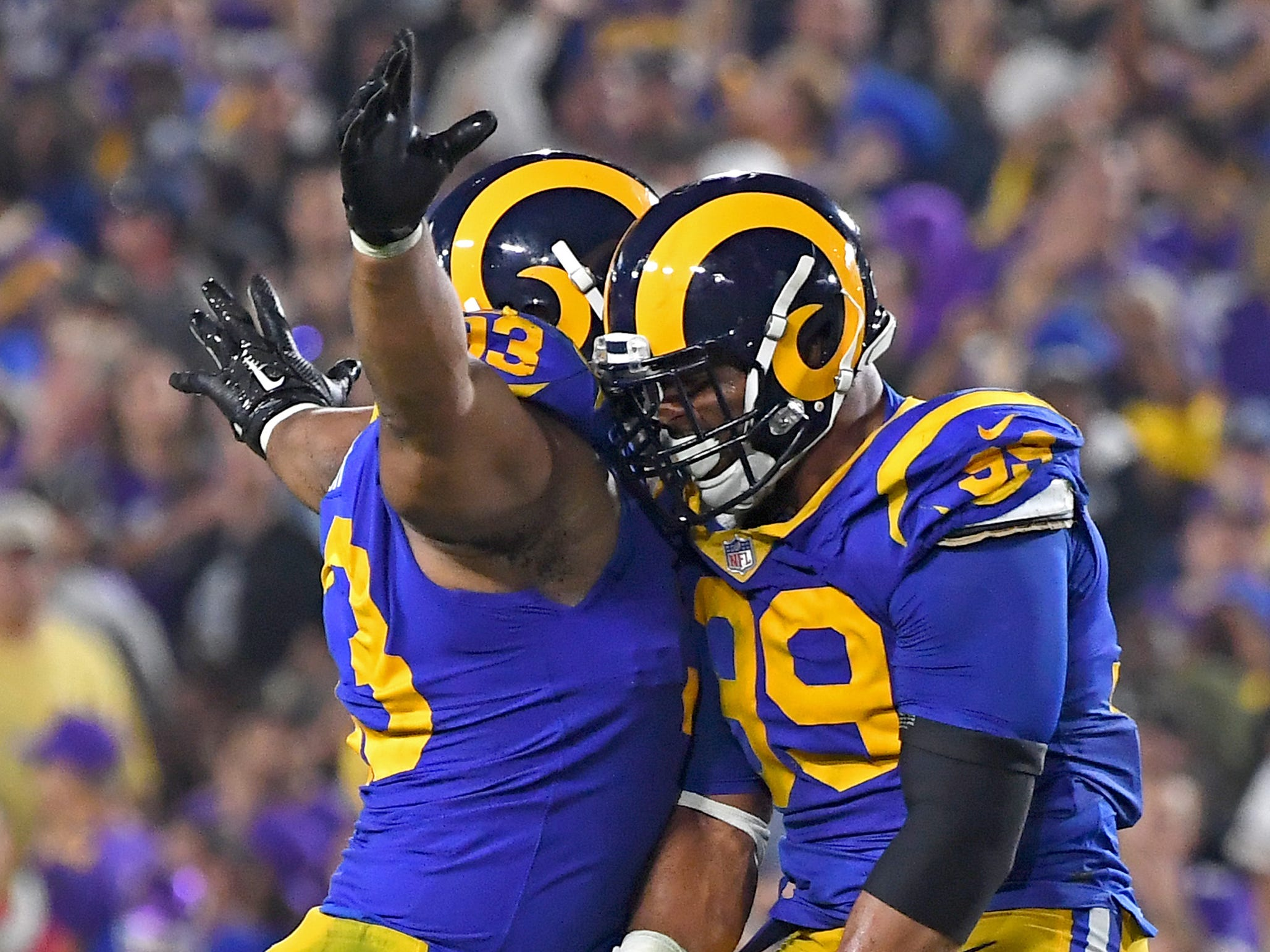 The Los Angeles Rams' Ndamukong Suh (left) and Aaron Donald (99) leap in the air and celebrate after a sack in the fourth quarter against the Minnesota Vikings.