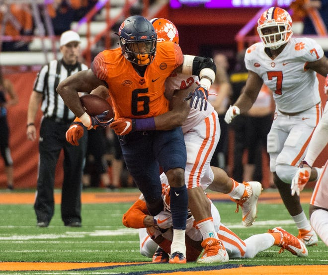 Syracuse tight end Ravian Pierce is tackled by Clemson defensive lineman Christian Wilkins during their game in 2017.