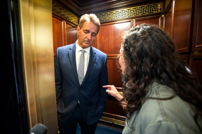 A woman who said she is a survivor of a sexual assault, right, confronts Republican Senator from Arizona Jeff Flake, left, in an elevator after Flake announced that he vote to confirm Supreme Court nominee Brett Kavanaugh in the Russell Senate Office Building in Washington, DC.