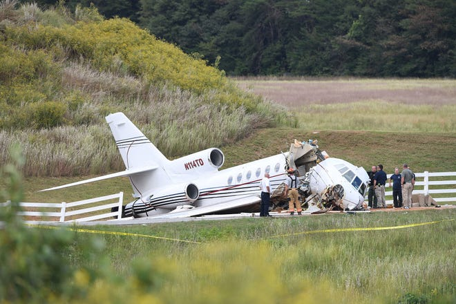First responders inspect a jet that crashed off a runway Thursday, Sept. 27, 2018, at the Greenville Downtown Airport in Greenville, South Carolina.