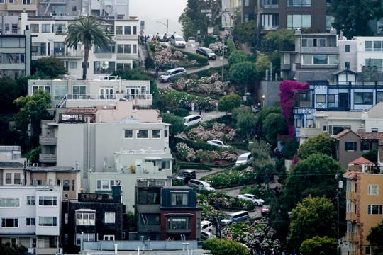 Cars line Lombard Street, the world's crookedest street in San Francisco. A state bill announced Monday could allow San Francisco to crate a toll and reservation system for the street.