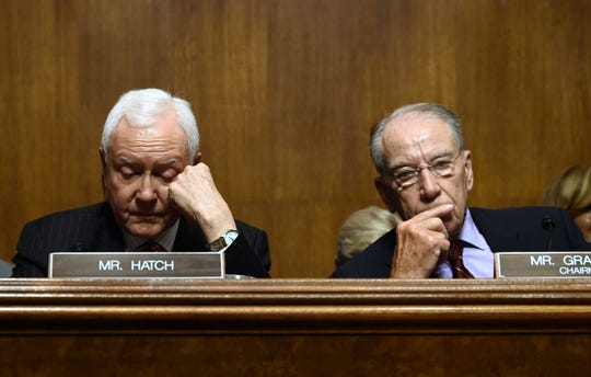 Senate Judiciary Committee chair Chuck Grassley and Senator Orrin Hatch wait during a hearing on Capitol Hill in Washington, DC on September 28, 2018, on the nomination of Brett M. Kavanaugh to be an associate justice of the Supreme Court of the United States. - Kavanaugh's contentious Supreme Court nomination will be put to an initial vote Friday, the day after a dramatic Senate hearing saw the judge furiously fight back against sexual assault allegations recounted in harrowing detail by his accuser. (Photo by Brendan SMIALOWSKI / AFP)BRENDAN SMIALOWSKI/AFP/Getty Images ORIG FILE ID: AFP_19K5B1