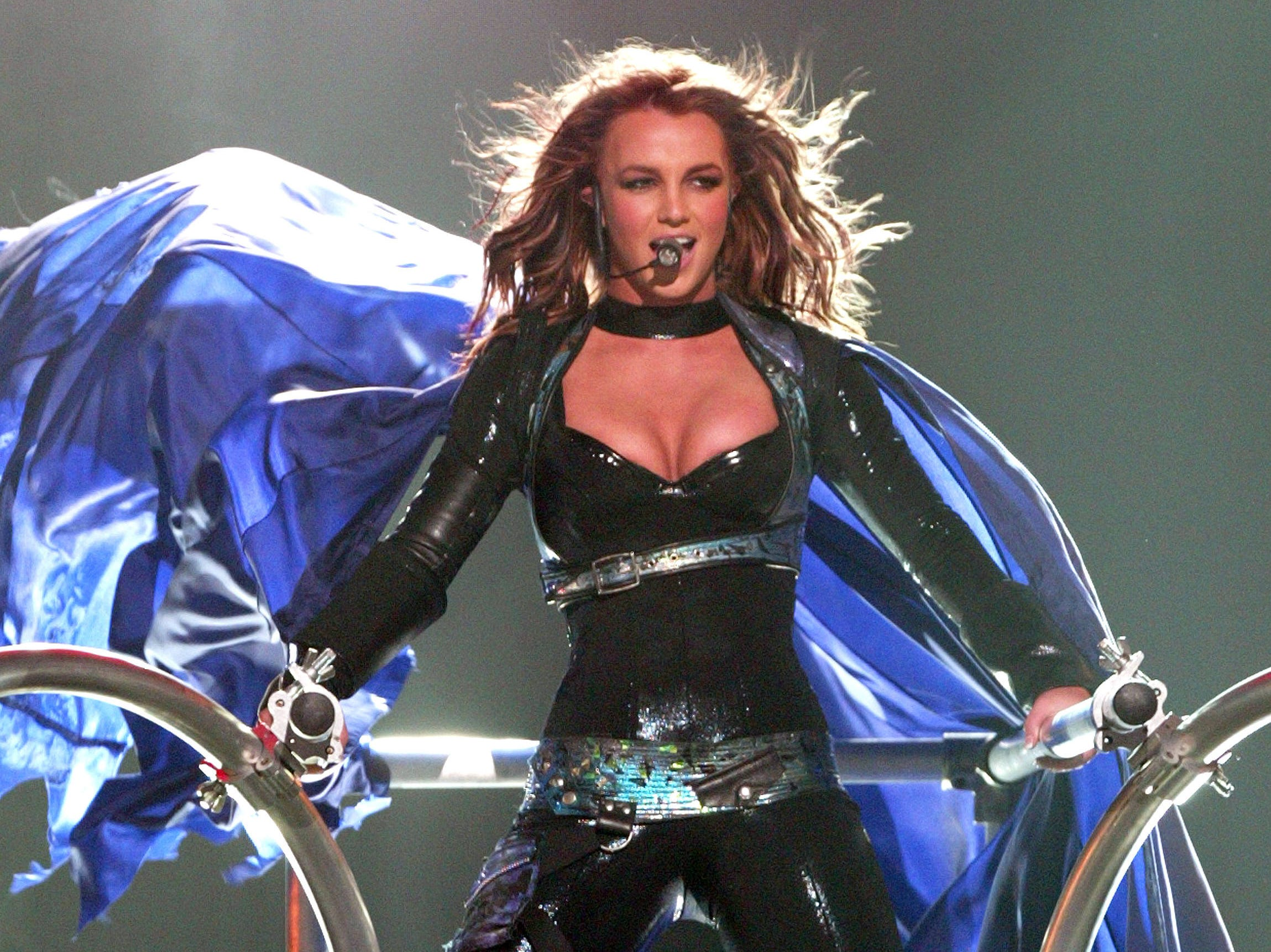 MIAMI - MARCH 28:  (U.S. TABS AND STAR MAGAZINE OUT) Singer Britney Spears performs onstage during Showtime's live broadcast of Britney's Onyx Hotel tour show at the American Airlines Arena March 28, 2004 in Miami, Florida. (Photo by Frank Micelotta/Getty Images) *** Local Caption *** Britney Spears ORG XMIT: 3133246 GTY ID:  3133246FM014_brit