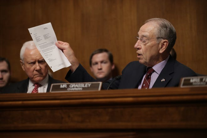 WASHINGTON, DC - SEPTEMBER 28: Senate Judiciary Committee Chairman Sen. Chuck Grassley (R) (R-IA) holds up a letter from Mark Judge's attorney during a committee meeting September 28, 2018 in Washington, DC. The committee met to discuss and later vote on the nomination of Judge Brett Kavanaugh to the U.S. Supreme Court prior to the nomination proceeding to a vote in the full U.S. Senate. (Photo by Chip Somodevilla/Getty Images) ORG XMIT: 775233899 ORIG FILE ID: 1046046186