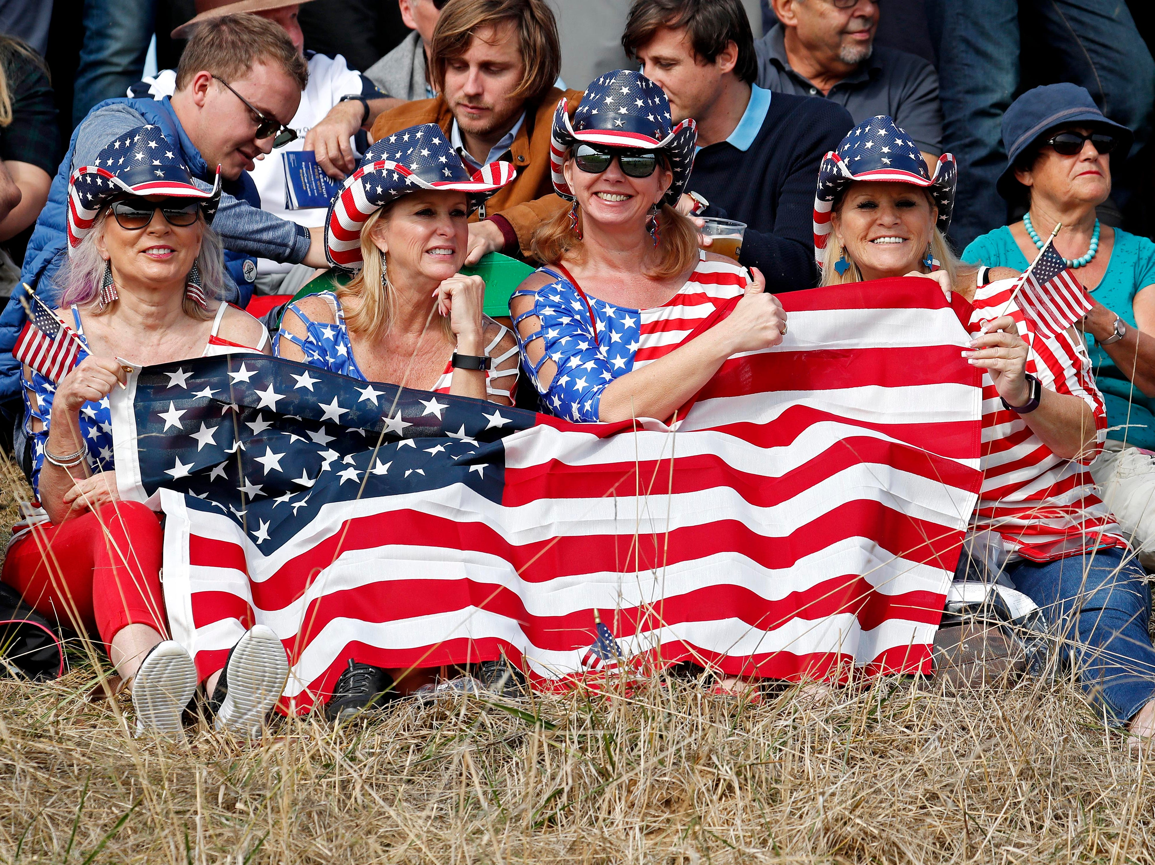 United States fans cheer on the 15th hole during the Ryder Cup Friday morning matches.
