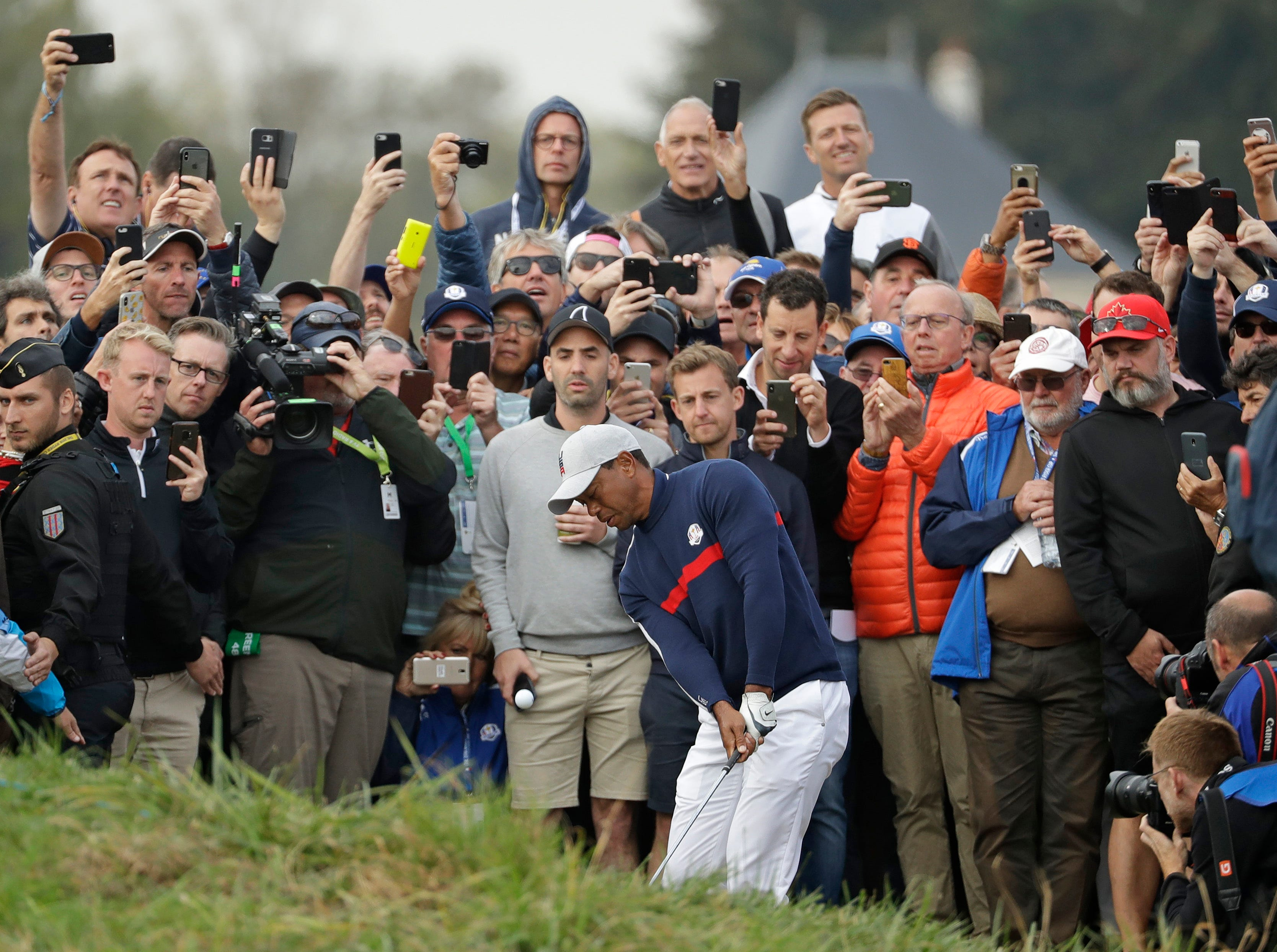 Tiger Woods chips on to the 6th green during a fourball match on the opening day of the 42nd Ryder Cup at Le Golf National in Saint-Quentin-en-Yvelines, on Sept. 28.