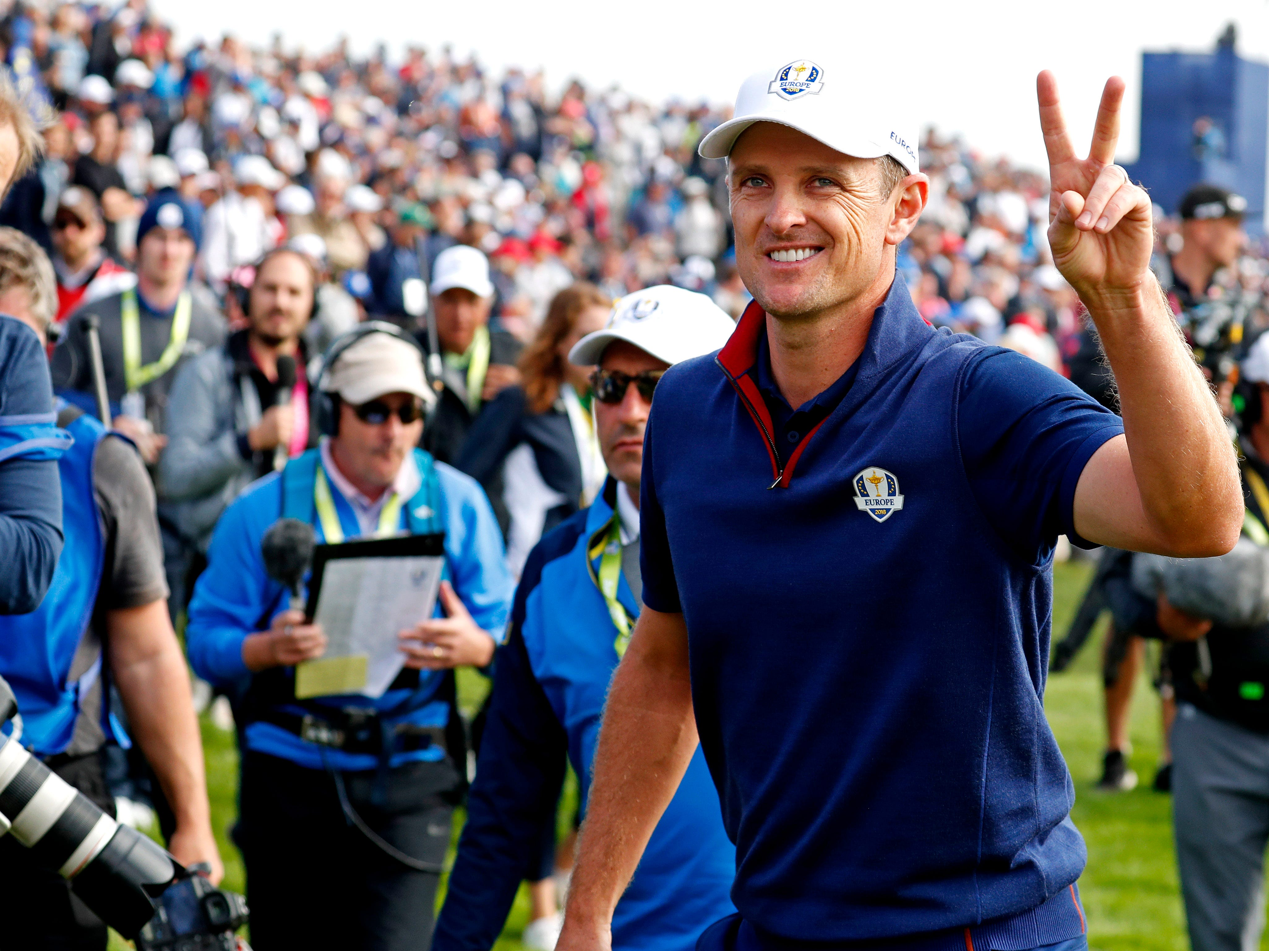 Europe's Justin Rose reacts on the 14th green during the Ryder Cup Friday morning matches.