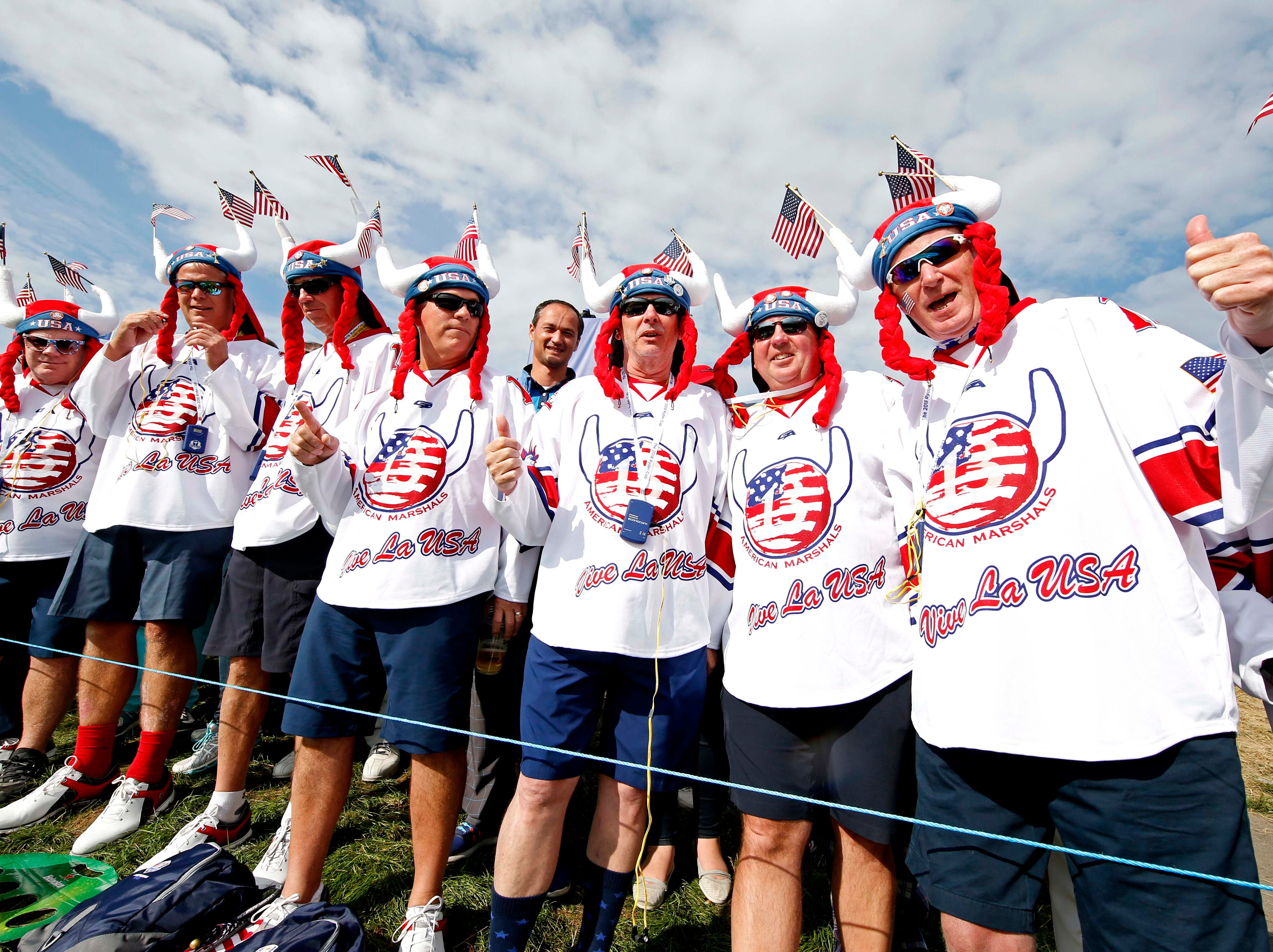 USA fans cheer on the 14th hole during the Ryder Cup Friday morning matches.