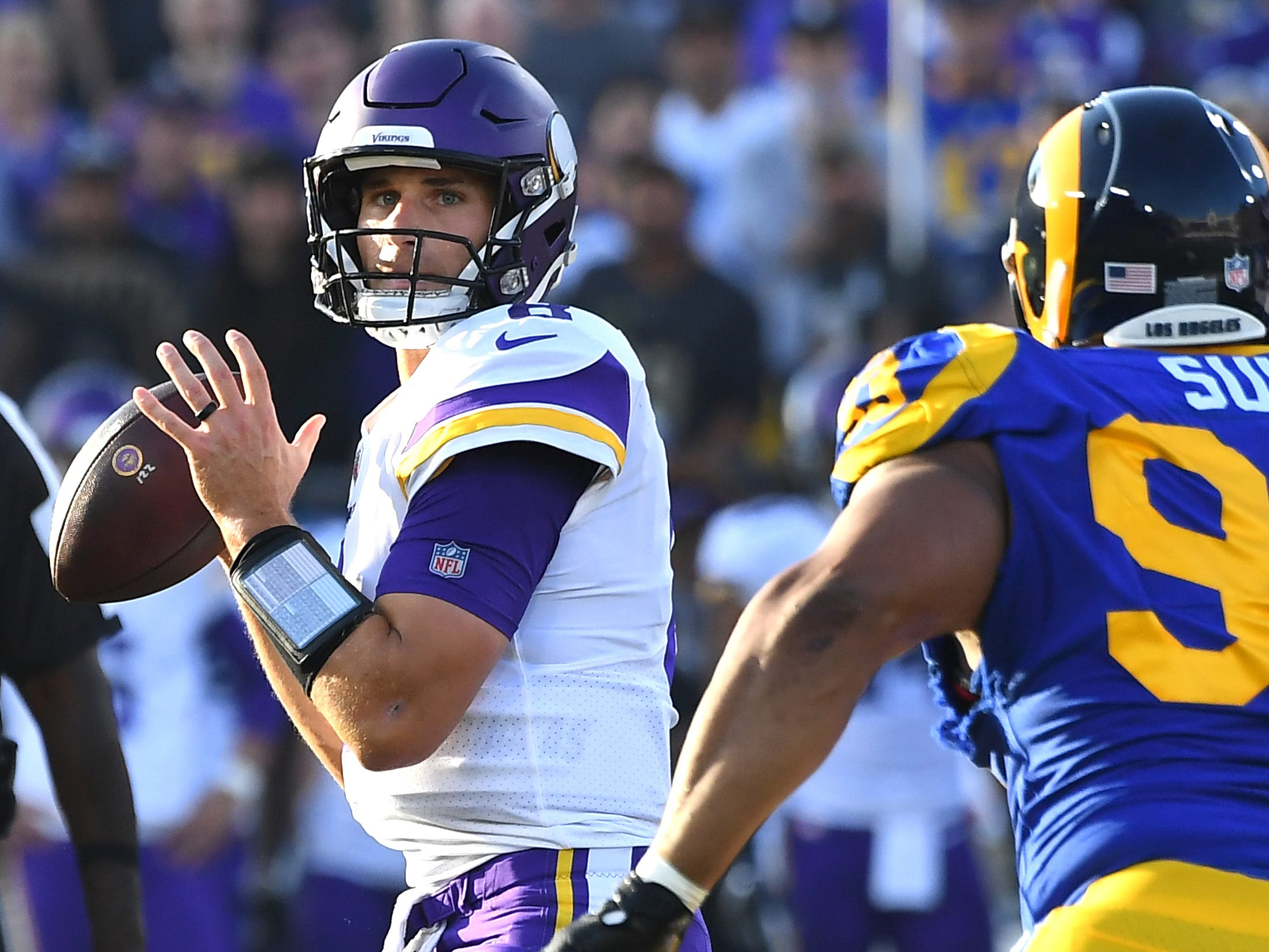 Minnesota Vikings quarterback Kirk Cousins throws a touchdown pass in the first quarter against the Los Angeles Rams at the Los Angeles Memorial Coliseum.