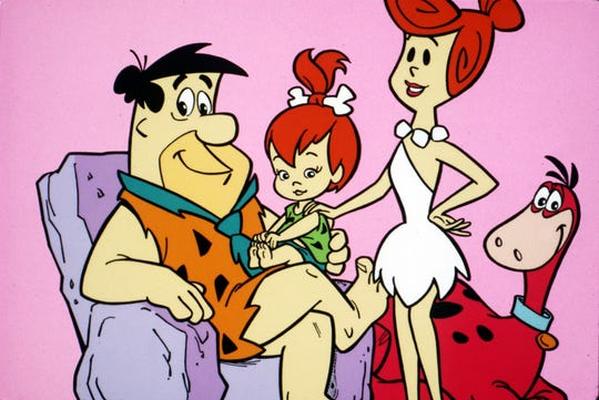 """Fred, Pebbles, Wilma and Dino in """"The Flintstones."""""""