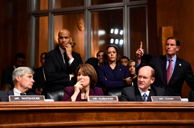 Senate Judiciary Committee members (L-R) Sheldon Whitehouse, Cory Booker, Amy Klobuchar, Kamala Harris, Christopher Coons, and Richard Blumenthal look on during a hearing on Capitol Hill in Washington, DC on September 28, 2018, on the nomination of Brett M. Kavanaugh to be an associate justice of the Supreme Court of the United States. - Kavanaugh's contentious Supreme Court nomination will be put to an initial vote Friday, the day after a dramatic Senate hearing saw the judge furiously fight back against sexual assault allegations recounted in harrowing detail by his accuser. (Photo by Brendan Smialowski / AFP)BRENDAN SMIALOWSKI/AFP/Getty Images ORIG FILE ID: AFP_19K5DK